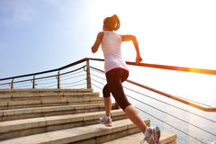 healthy-lifestyle-woman-legs-running-stone-stairs-sports-seaside-39906607